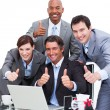 Enthusiastic business team with thumbs up — Stock Photo #10289169