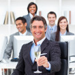 Victorious manager and his team drinking champagne — Stock Photo