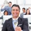 Prosperous manager and his team drinking champagne — Stock Photo #10289180