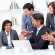 Stock Photo: Laughing businesswomapplauded by her team