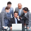 Assertive manager on phone and his team — Stock Photo
