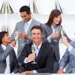 Cheerful business toasting with Champagne — Stock Photo