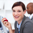 Portrait of a smiling businesswoman eating an apple — Stock Photo #10289292