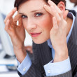 Young businesswoman having a headache — Stock Photo