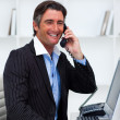 Attractive businessman making a phone call — Stock Photo