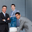 Multi-ethnic business team at water cooler — Stock Photo