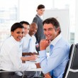 Foto Stock: Multi-ethnic business team at meeting