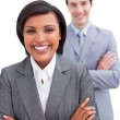Beautiful businesswoman posing in front of her colleague - Stock Photo