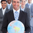 Ambitious business team showing a terrestrial globe — Stock Photo