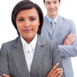 Stock Photo: Ethnic businesswomposing in front of her colleague