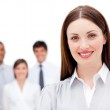 Attractive businesswoman with her team in the background — Stock Photo