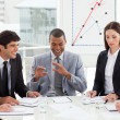 Multi-ethnic business team discussing a new strategy - Stock Photo