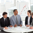 Business group studying sales report — Stock Photo
