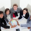 Smiling Business team holding terrestrial globe — Stockfoto #10289497