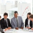 Multi-ethnic business team sitting around a conference table — Stock Photo