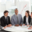 Attractive manager in a meeting with his team — Stock Photo