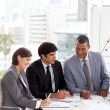 A Business group showing diversity discussing a new strategy - Stock Photo