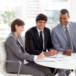 Stock Photo: Young business sitting at a conference table
