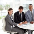 Royalty-Free Stock Photo: Three co-workers smiling at the camera