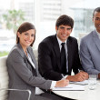 Multi-ethnic co-workers smiling at the camera — Stock Photo #10289541