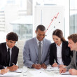 Foto Stock: Multi-ethnic business team working together