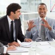 Stock Photo: Happy international business discussing a budget plan