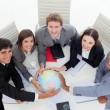 Stock Photo: High angle of a diverse business team holding a terrestrial glob