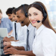 Businesswoman with headset on smiling at the camera — Stock Photo #10289734