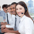 Smiling business with headset on — Stock Photo #10289752