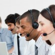 Multi-ethnic customer service agents in a call center — Stock Photo #10289756