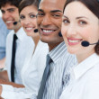Stock Photo: Customer service agents smiling at camera
