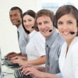 Stock Photo: Multi-ethnic business with headset on