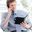 Stock Photo: Serious businessmplanning appointment on phone