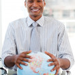 Enthusiastic businessmshowing terrestrial globe — Foto de stock #10289877