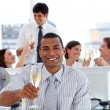 Fortunate business team drinking champagne — Stock Photo