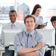 Stock Photo: Portrait of a successful business team at work