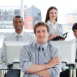 Stock Photo: Portrait of positive business team at work
