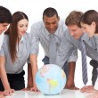A meeting of business team around a terrestrial globe — Stock Photo