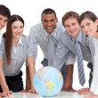Portrait of business team around terrestrial globe — Stock Photo #10289917