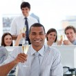 Lucky business team drinking champagne — Stock Photo