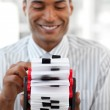Smiling businessman holding a business card holder — Stock Photo