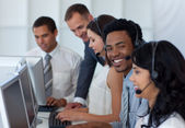 Manager talking to his business team in a call center — Stock Photo