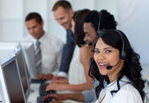 Businesswoman in a call center with her multi-ethnic team — Stok fotoğraf