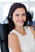Portrait of a smiling businesswoman in a call centre — Stock Photo