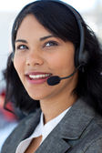 Portrait of a businesswoman talking on a headset — Stock Photo