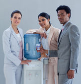 Business with a water cooler in office — Stock Photo