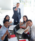 Business in a meeting with thumbs up — Stock Photo