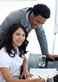 Afro-American businessman talking to his colleague — Stock Photo