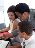Afro-American businessman working with his colleagues — Stock Photo