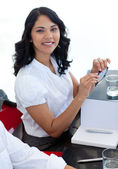 Businesswoman with glasses working in a meeting — Stock Photo